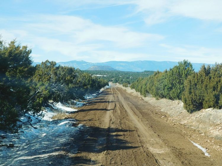 nice muddy road The Way Forward NewMexicoTRUE Newmexicophotography Rural Scene Newmexicoskies Newmexicomountain Newmexicoskys Outdoors Land Vehicle Transportation Tranquil Scene Beauty In Nature Mountain Peak Scenics Landscape