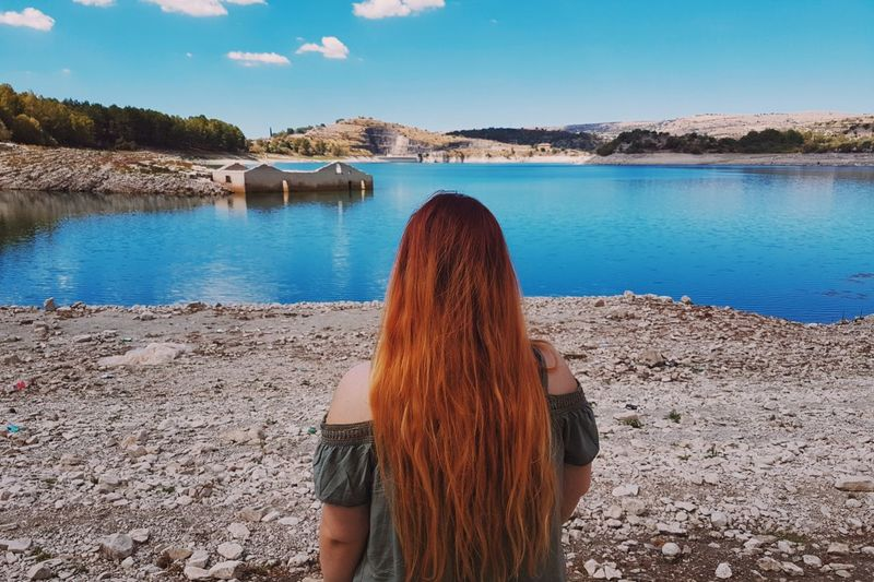 Water Reflections Rear View Only Women One Woman Only Beach Sand Women One Person Human Body Part Long Hair Nature Summer Looking Redhead People Adults Only Human Back Blue Lake Naturelovers Blue Sky Blue Water Outdoors Beauty In Nature Your Ticket To Europe Lost In The Landscape