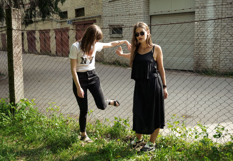 Echoes of the Ongoing Riot Fence Suburbs Grass Girls Sun Rays Concrete Garages Glasses Black Dress İ Love NY Women Hanging Out Linas Was Here International Women's Day 2019