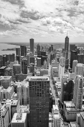 Aerial View Architecture Building Exterior Built Structure City City Life Cityscape Crowded Day Development Downtown Growth Modern Outdoors Sky Skyline Skyscraper Tall Travel Destinations Urban Skyline