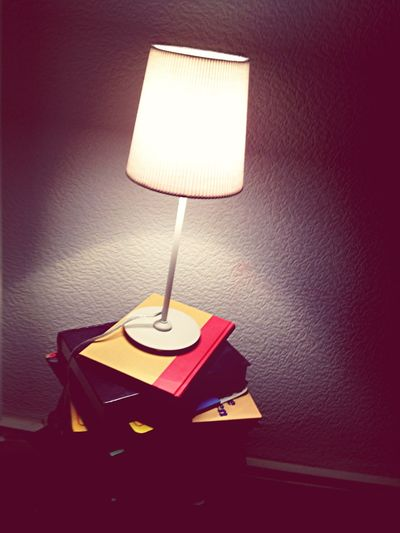 old books and a lamp