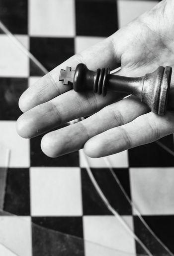 Close-up of human hand playing guitar