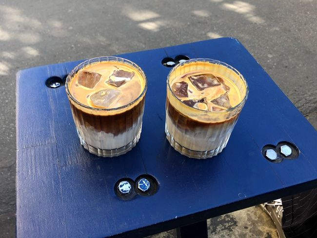 Cafe Ice Cubes Cold Coffee Coffee ıced Coffee High Angle View Food And Drink Table No People Still Life Metal Close-up Day Food Blue Freshness Drink City Sunlight