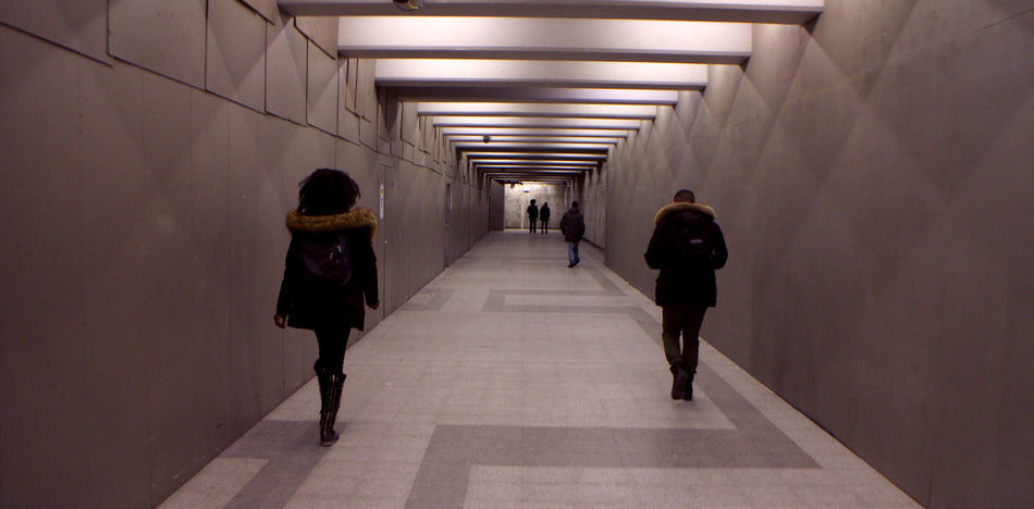 Photos in and around Montreal, winter of 2018. Architecture The Way Forward Direction Illuminated Walking Indoors  Built Structure Underground Walkway Underpass Light Ceiling Diminishing Perspective Wall - Building Feature People Group Of People Arcade Subway Real People Rear View Lighting Equipment Corridor Building
