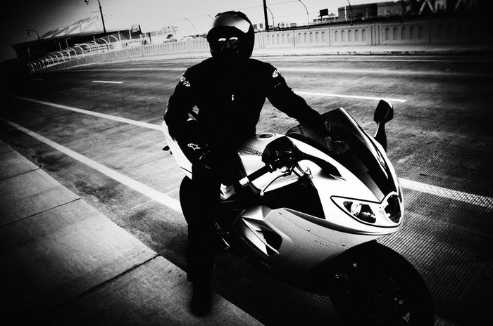 Motorcycle Speed Racer Triumph Street Photography Capture The Moment Light And Shadow Street Poetry Black And White Monochrome ExpressYourself Eye4photography  Streetphoto_bw Getting Inspired EyeEm Best Shots Portrait Streetphotography City Life Stylish