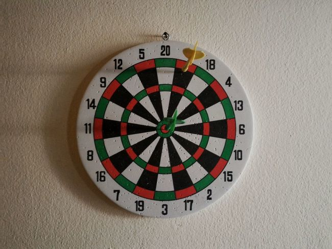 Indoors  Competition Sports Target Multi Colored No People Close-up Day Darts Toy Score Winner Loser Shadows & Lights Full Frame Backgrounds Center Goal Circle Concrete Wall