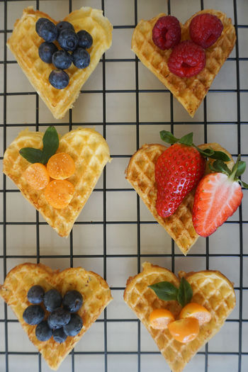 waffle hearts with fresh berries Waffle Dessert Berry Fruit Berry Strawberry Blueberry Raspberry Physalis Directly Above Gelatin Dessert Dessert Variation Sweet Food Food And Drink Cooling Rack Tart - Dessert Baked Cake Slice Of Cake