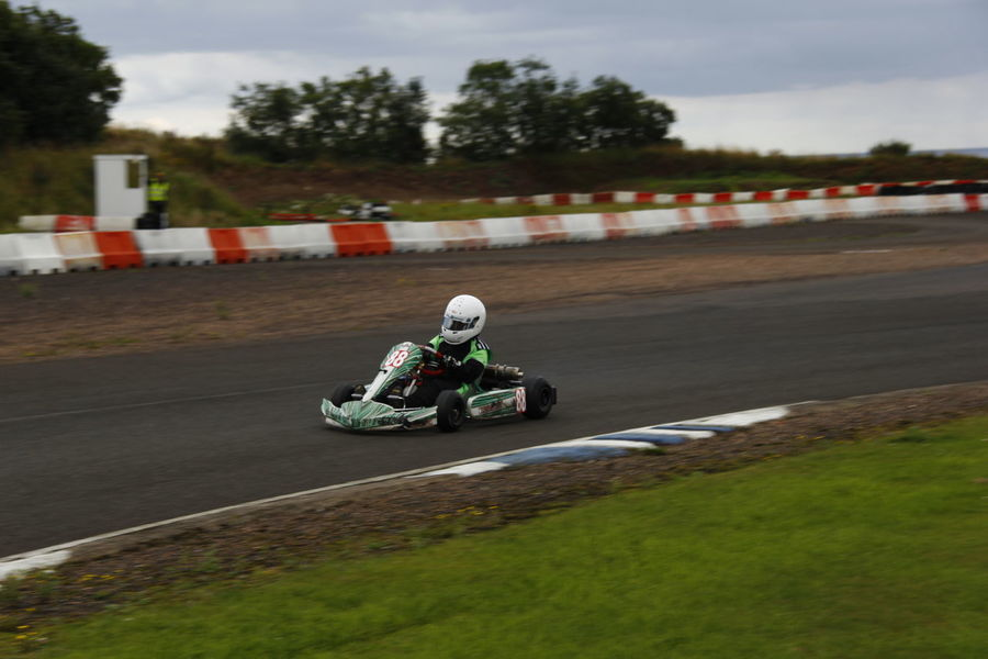 Auto Racing Competition Competitive Sport Crash Helmet Day Headwear Helmet Land Vehicle Lifestyles Mode Of Transport Motocross Motorcycle Motorcycle Racing Motorsport One Person Outdoors Racecar Real People Riding Speed Sport Sports Clothing Sports Race Sports Track Transportation