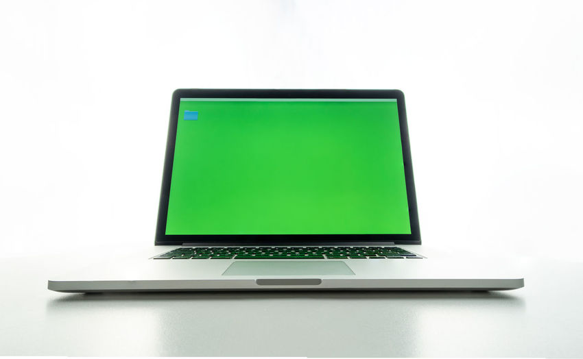 Low angle view of laptop on white background