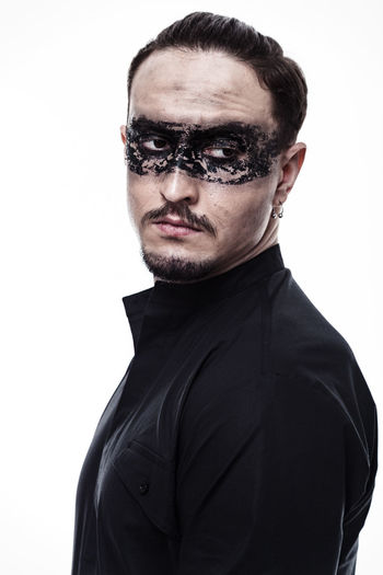 Close-Up Of Man With Face Paint Against White Background