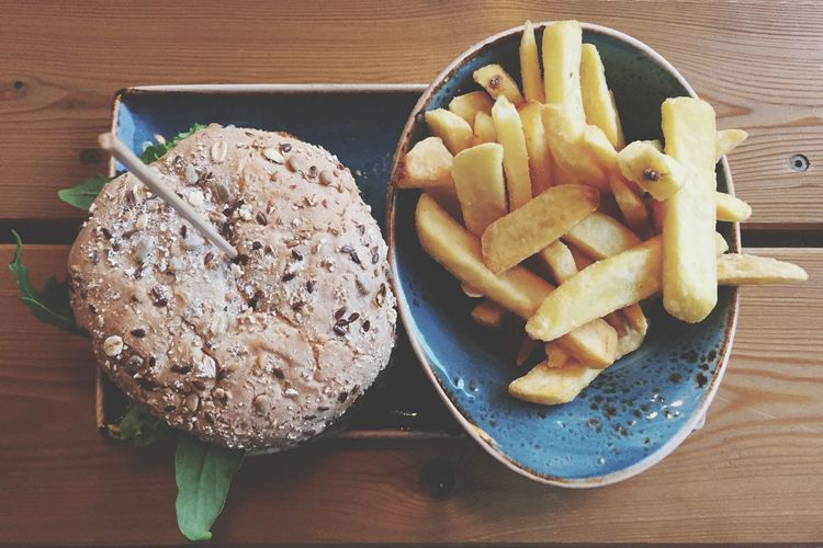 High angle view of fries with burger