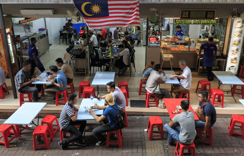 Kuala Lumpur, Malaysia: January 24, 2018: Tourists and local people eating in a Malaysian restaurant in Kuala Lumpur ASIA Kuala Lumpur Metro Sentral Senayan South East Asia Food Infrastructure Malaysia Restaurant Sentral Southeastasia Subway