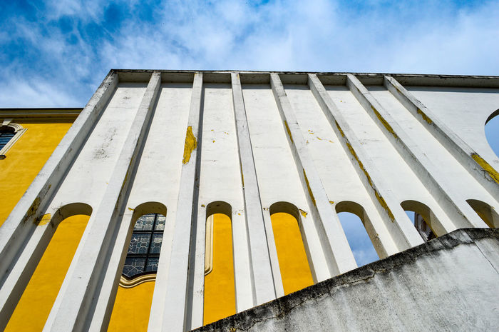 Architectural Detail Architectural Feature Architecture Architecture_collection Building Exterior Built Structure City Cityexplorer Cloud - Sky Façade Low Angle View Neighborhood Map Sky The Architect - 2017 EyeEm Awards Urban Geometry Urbanphotography Yellow Paint The Town Yellow