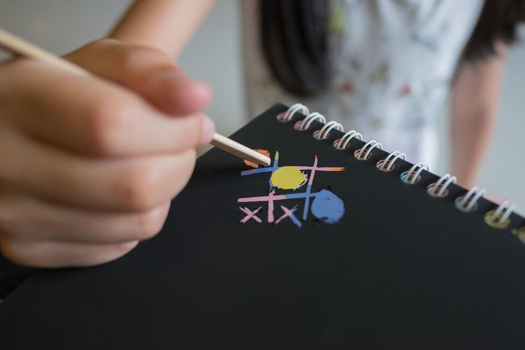 Family Home Playing Games Playtime Art And Craft Black Board Child Childhood Creativity Day Game Girl Hand Human Body Part Human Hand Indoors  Kid Midsection Multi Colored One Person Paper Papers Scratching