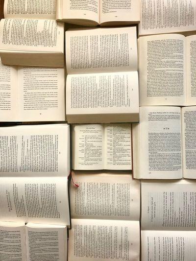 Wortspielereien Bücherliebe Reading Bücherstapel Bücher  Book Text Full Frame Communication Backgrounds No People Indoors  Paper Close-up