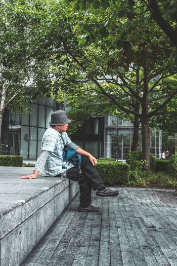 Man sitting on footpath in park