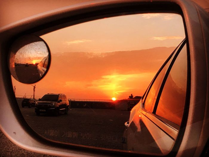 EyeEmNewHere Painting With Light EyeEm Nature Lover EyeEm Best Shots Sunset Transportation Mode Of Transportation Sky Car Motor Vehicle Land Vehicle Orange Color Side-view Mirror Cloud - Sky Glass - Material Nature