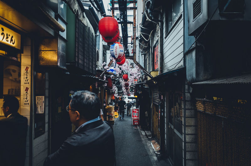 Backstreets & Alleyways Enjoying The View Izakaya Japan Japan Lovers Japanese Culture Japanese Style Old Meets New Perspective Shinjuku Simple Moment TOKYO TOKYO Old Meets New Tokyo Travel Urban Exploration Adult Alley Architecture Building Building Exterior Built Structure City Communication Direction Enjoying Life Illuminated Incidental People Japan Travel Leisure Activity Lifestyles Lighting Equipment Men Narrow Street One Person Outdoors People Real People Rear View Restaurant Sign Street Travel Destinations Urban The Street Photographer - 2018 EyeEm Awards The Architect - 2018 EyeEm Awards The Photojournalist - 2018 EyeEm Awards #urbanana: The Urban Playground