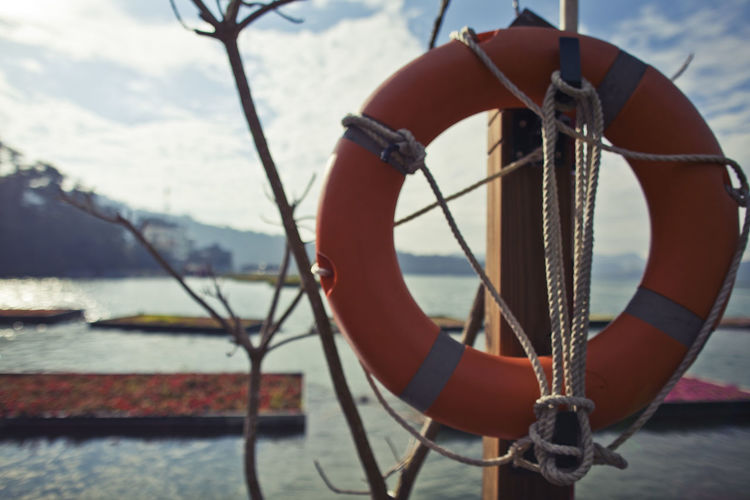 Close-up of rope tied to sea against sky