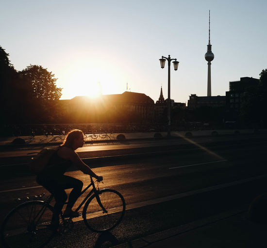 Golden hour in your face. Architecture Bicycle Building Exterior Built Structure City Land Vehicle Lens Flare Mode Of Transportation Nature One Person Outdoors Real People Riding Silhouette Sky Spire  Sun Sunlight Sunset Tall - High Tower Transportation Travel Capture Tomorrow