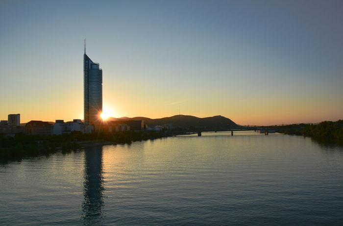 Built Structure River Skyscraper Sunset Water