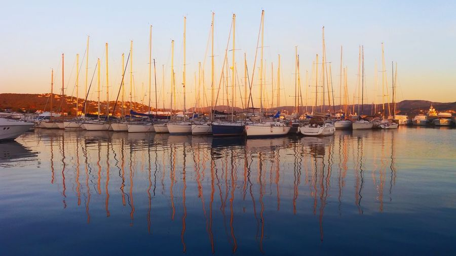 Reflection Sunset Tranquil Scene Water Tranquility Sailboat Marina Travel Destinations Blue Sunlight Sea Harbor No People Outdoors Nature Hitchhiking Colour Your Horizn A New Beginning