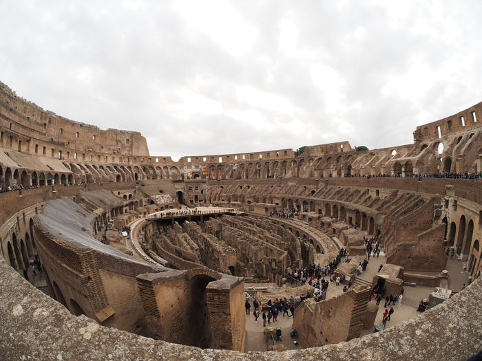 Colosseo Ancient Ancient Civilization Ancient History Arch Archaeology Architecture Arts Culture And Entertainment Built Structure Cloud - Sky Day History Large Group Of People Leisure Activity Nature Old Ruin Outdoors People Real People Sky The Past Tourism Travel Travel Destinations Vacations