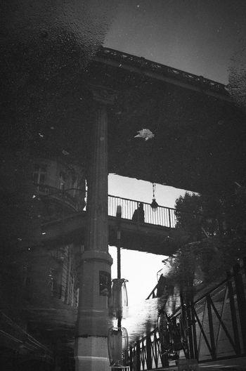 Streetphotography Blackandwhite Monochrome Reflection Rain Urban Lifestyle Shadow Ricoh Gr Silhouette Pont De Bir-hakeim