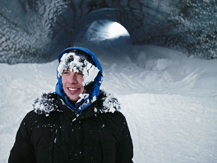 Portrait of smiling man covered with snow