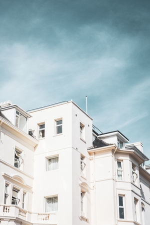Modern building against blue sky EyeEm Best Shots Apartment Architecture Balcony Blue Building Building Exterior Built Structure City Cloud - Sky Day House Low Angle View Nature No People Outdoors Residential District Sky Street Photography Sunlight Urban Landscape White Color Window