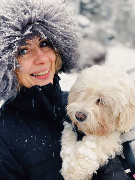 Woman with dog in the winter Maltese Dog Dog Pets Mature Adult Mature Women Portrait Real People One Person Animal Hair Looking At Camera Happiness Smiling Warm Clothing Domestic Animals Women Winter Outdoors Lifestyles Mammal