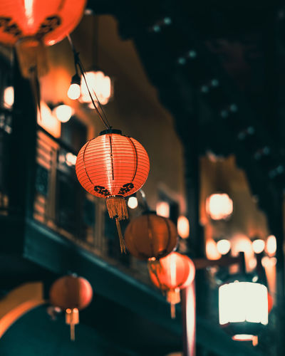 Low angle view of illuminated lanterns hanging outdoor