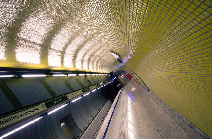 Colors Dark Futuristic Light Lights Modern Station Underground Well Lit Day Illuminated Indoors  Motion One Person People Refelction  Subway Tile Tiles Transportation Travel Destinations Tunnel Yellow Paint The Town Yellow