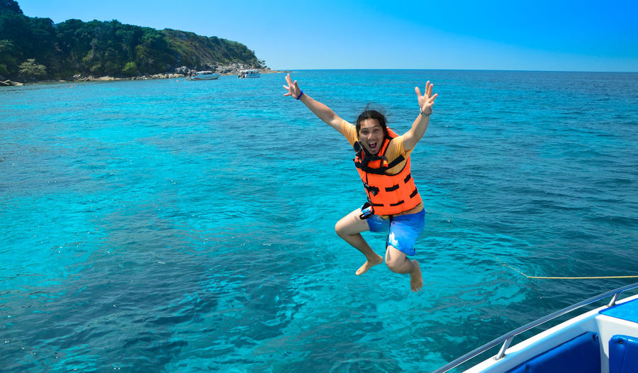 Jumping from the boats Sea Water Leisure Activity One Person Nature Arms Raised Lifestyles Blue Day Emotion Trip Mid-air Real People Holiday Vacations Beauty In Nature Arms Outstretched Outdoors Excitement Jumping From Boat Exiting Beautiful Sea Scared Fun Whoop