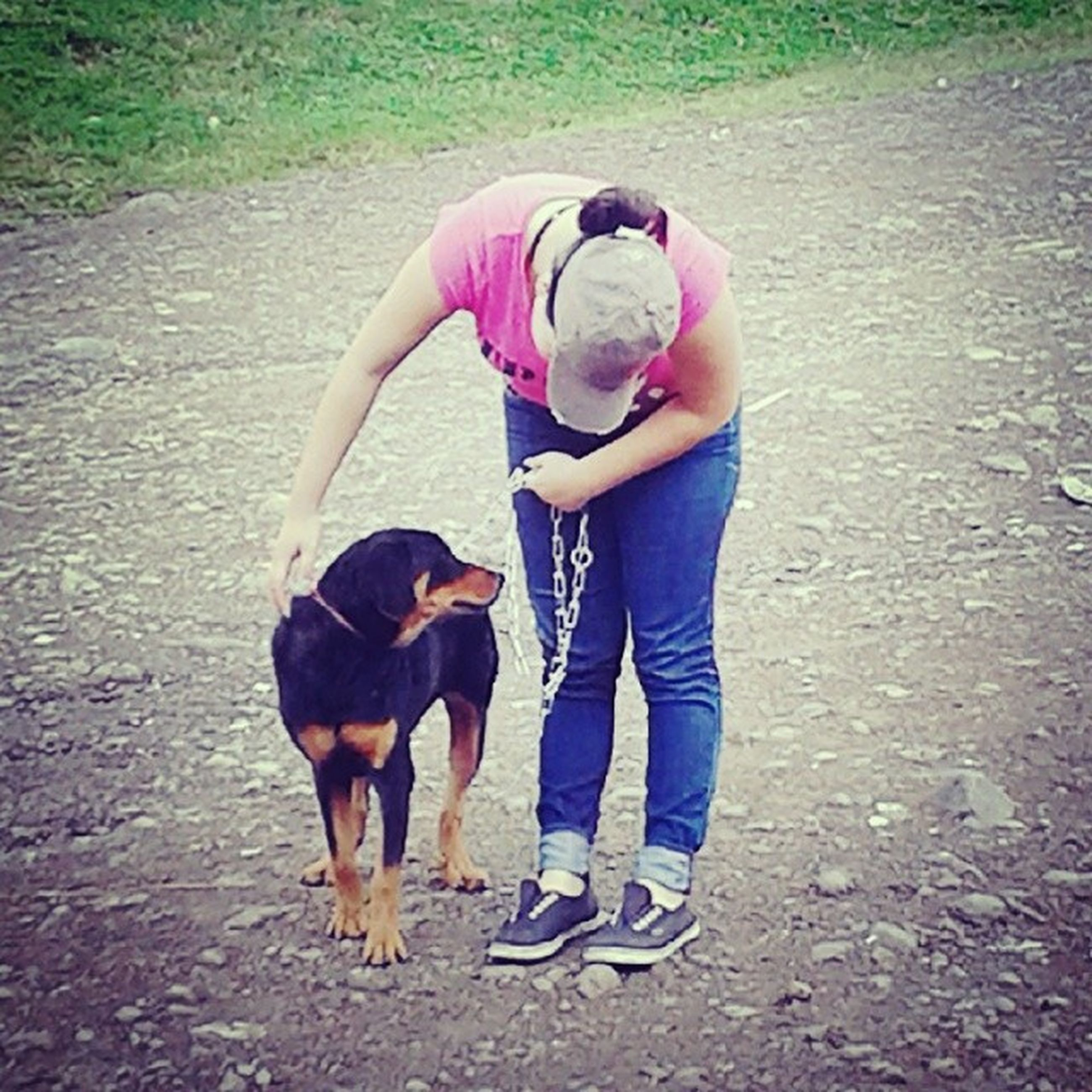 domestic animals, animal themes, dog, mammal, one animal, pets, full length, togetherness, lifestyles, casual clothing, leisure activity, pet leash, two animals, bonding, pet owner, rear view, standing