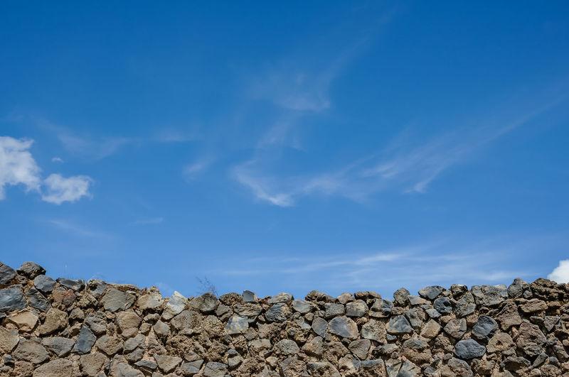 Stack of rocks against blue sky