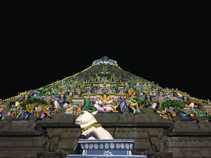 Traditional temple against sky at night