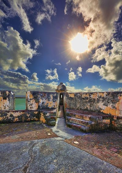 Garita at el Morro, Old San Juan, Puerto Rico Sunlight Sunbeam History Cloud - Sky The Street Photographer - 2017 EyeEm Awards The Architect - 2017 EyeEm Awards Sun Architecture Outdoors Ancient Day Building Exterior Ancient Civilization Travel Destinations No People Nature Beauty In Nature Landscape Wanderlust Rickeherbertphotography Water Travel Photography Architecture Multi Colored Live For The Story Been There.