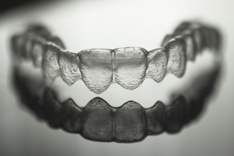 Close-up of artificial ring over white background