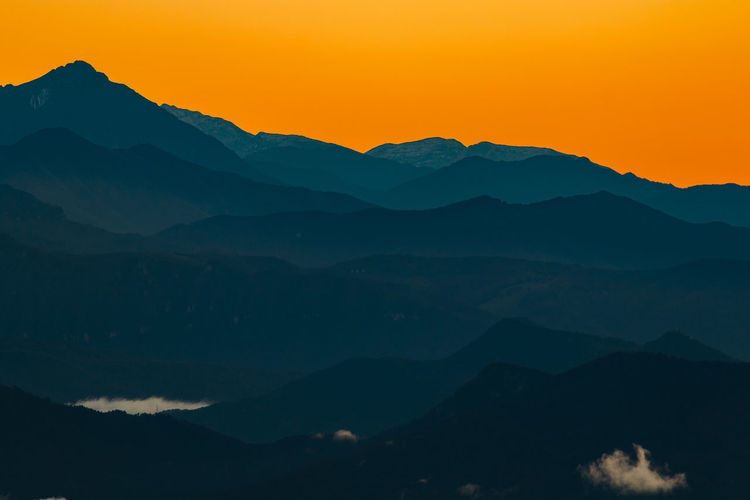 Mountains at sunrise Beauty In Nature Clear Sky Dawn Dawn Of A New Day Idyllic Landscape Landscape #Nature #photography Landscape_Collection Landscape_photography Landscapes Majestic Mountain Mountain Range Nature Photography Nature_collection Naturelovers Orange Color Scenics Sunrise Sunrise - Dawn Sunrise_Collection Sunrise_sunsets_aroundworld Sunset Tranquil Scene Tranquility