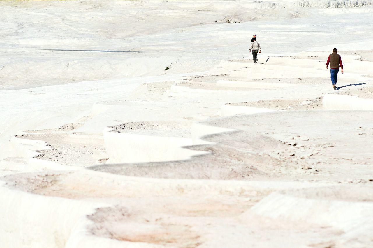People visiting dry travertine pool in pamukkale