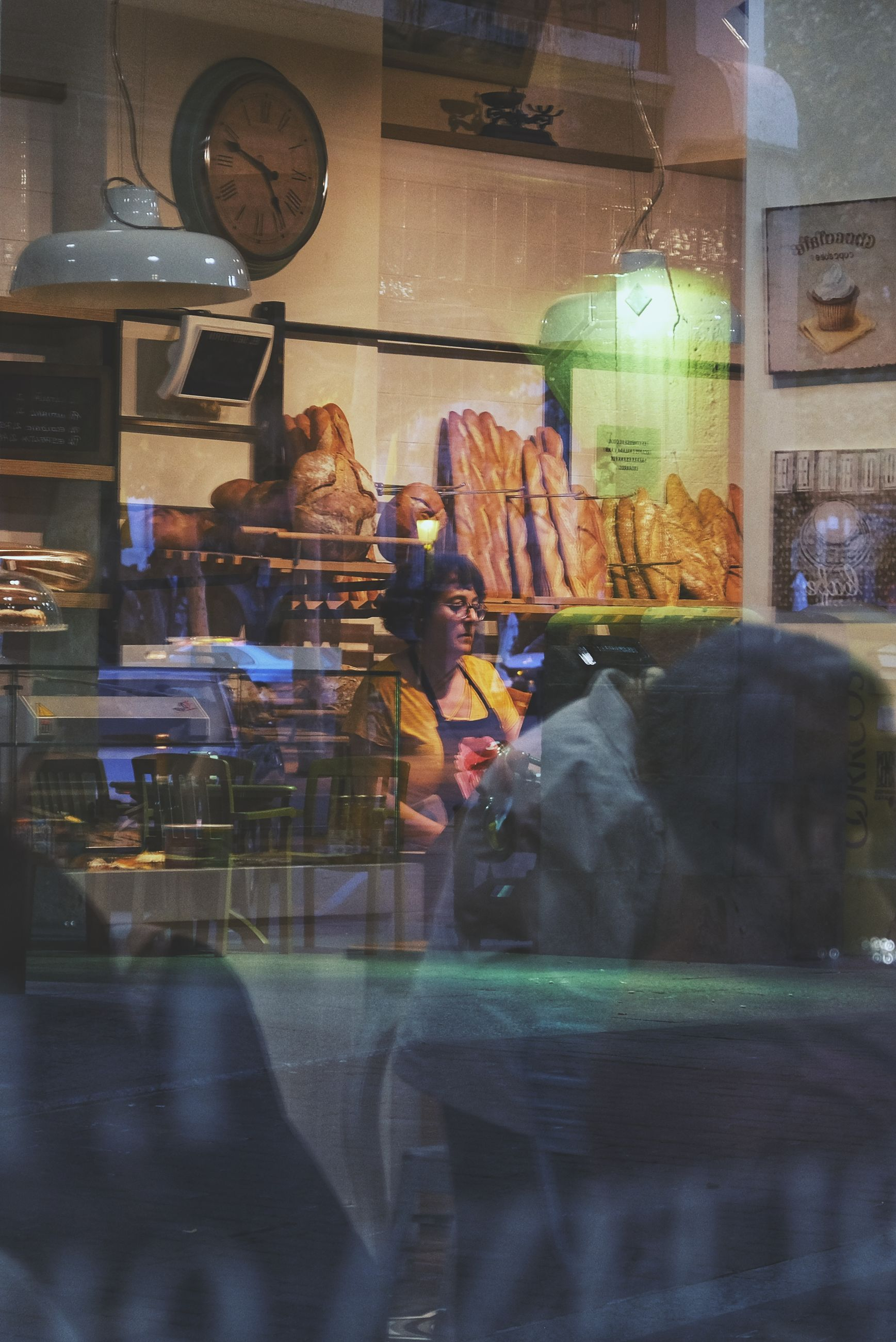 store, glass - material, retail, transparent, reflection, shopping, window, retail display, store window, incidental people, illuminated, business, indoors, choice, for sale, real people, adult, women, food and drink, sale, consumerism