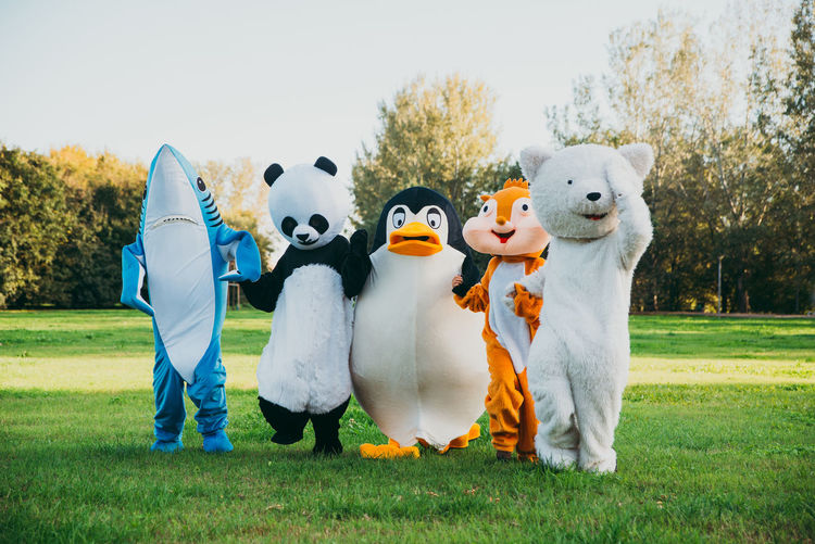 People wearing costume standing at park outdoors