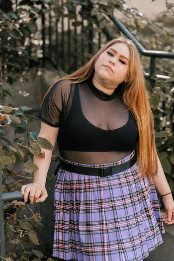 Trendy plus size woman in mini skirt