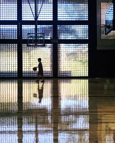 Basketball Reflection Real People One Person Architecture Built Structure Window Silhouette Indoors  Transparent Glass Building