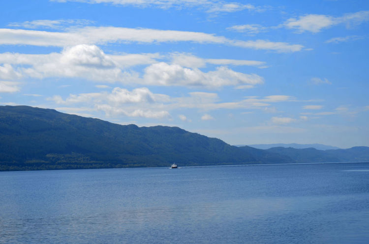 Beautiful Green Loch  Nature Nessy Peace Scotland Beauty In Nature Blue Boat Day Lochness Nature Ness No People Outdoors Scenics Sky Tranquility Water