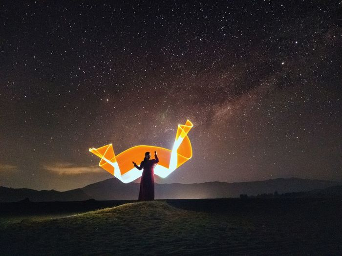 Beautiful light painting against sky at night