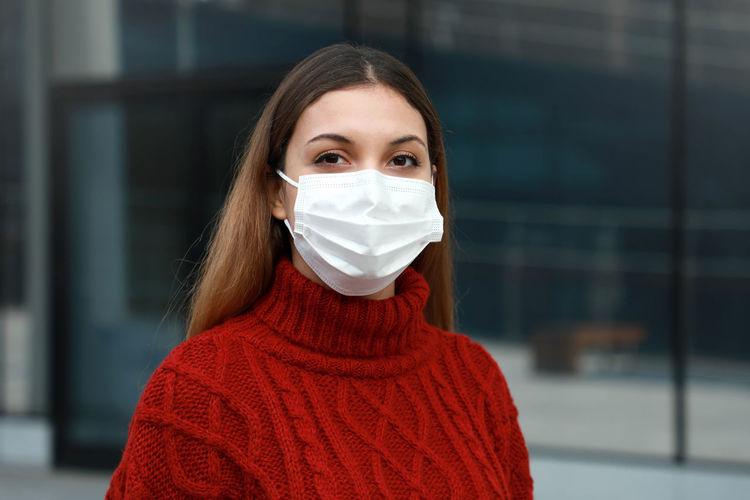 Portrait of beautiful woman wearing mask outdoors