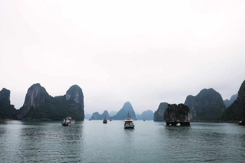 Backpacking Beauty In Nature Boat Calm Halongbay Idyllic Outdoors Rock Formation Scenics Sky Transportation Travel Destinations Vietnam Wanderlust Water