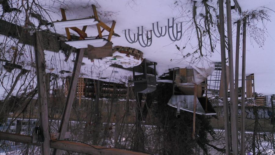 Empty chairs and tables on snow covered land